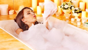 mother relaxing in bubble bath