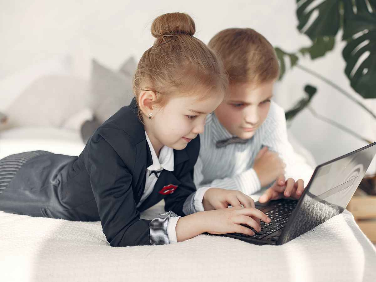 boy and girl studying happily