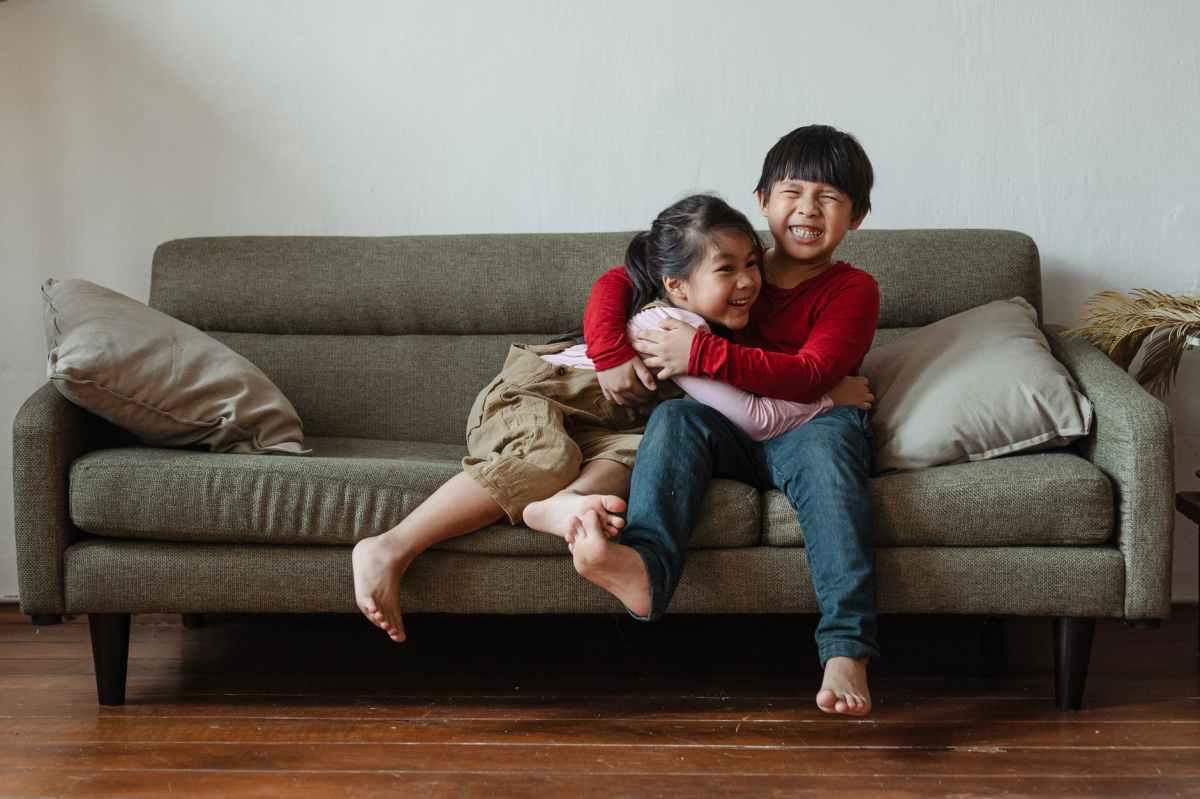 happy siblings cuddling