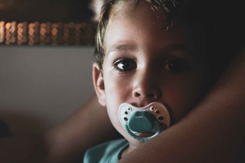 young boy with pacifier
