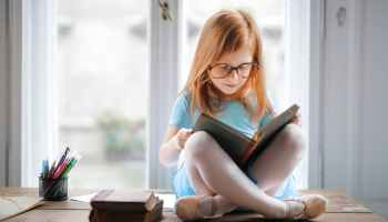 child reading independently