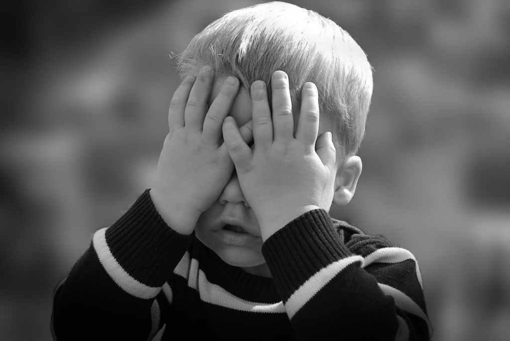 child playing peekaboo