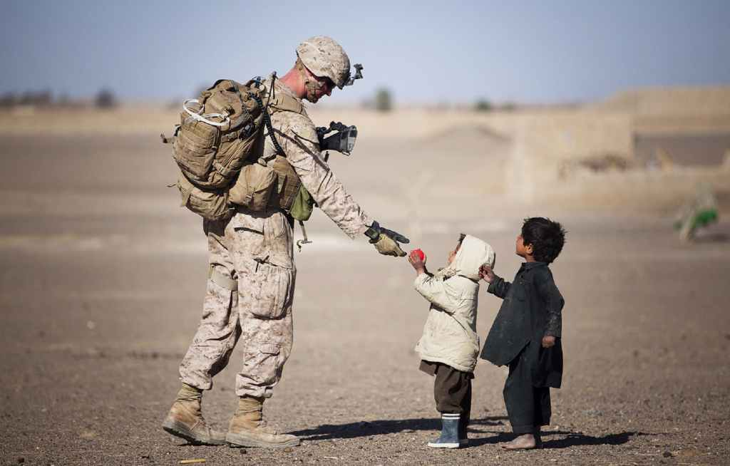soldier caring for children